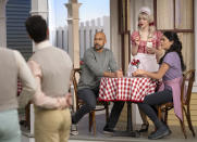 """This image released by Apple TV+ shows Keegan-Michael Key, background from left, Dove Cameron and Cecily Strong in a scene from """"Schmigadoon!,"""" premiering Friday. (Apple TV+ via AP)"""