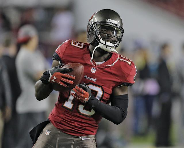 Tampa Bay Buccaneers wide receiver Mike Williams (19) catches a pass before an NFL football game against the Carolina Panthers Thursday, Oct. 24, 2013, in Tampa, Fla. (AP Photo/Chris O'Meara)