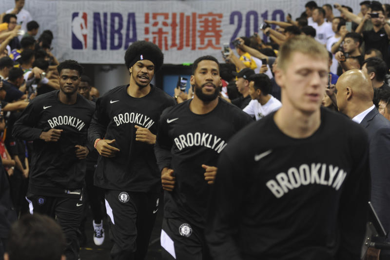 Brooklyn Nets' players arrive for a match against Los Angeles Lakers at the NBA China Games 2019 in Shenzhen in south China's Guangdong province on Saturday, Oct. 12, 2019. (Color China Photo via AP)
