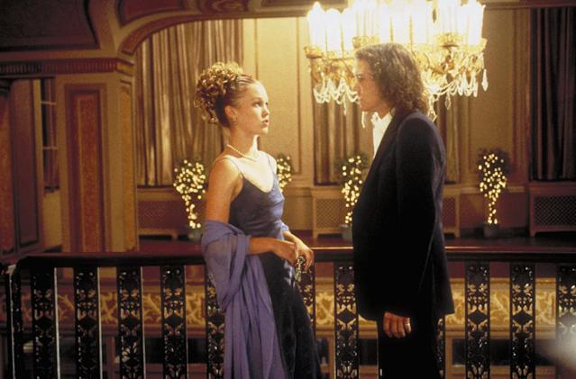 <p>Cat Stratford (Julia Stiles) looks perfectly '90s in this light royal blue dress that she claims she just had lying around. Heath Ledger looks perfect without the bow tie, which sums up how badass dreamy he was without trying. (Photo: Everett Collection) </p>