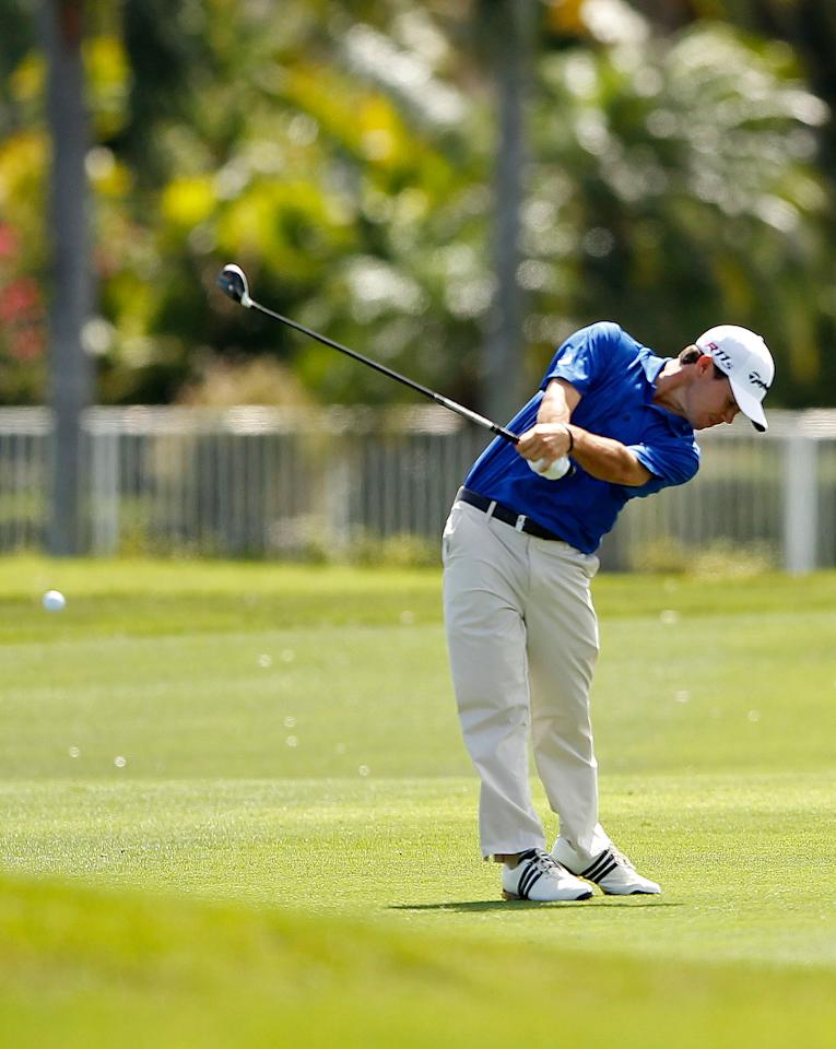 PALM BEACH GARDENS, FL - MARCH 02:  Brian Harman hits his approach shot  on the 18th hole on his way to posting a course record 61 during the second round of the Honda Classic at PGA National on March 2, 2012 in Palm Beach Gardens, Florida.  (Photo by Mike Ehrmann/Getty Images)