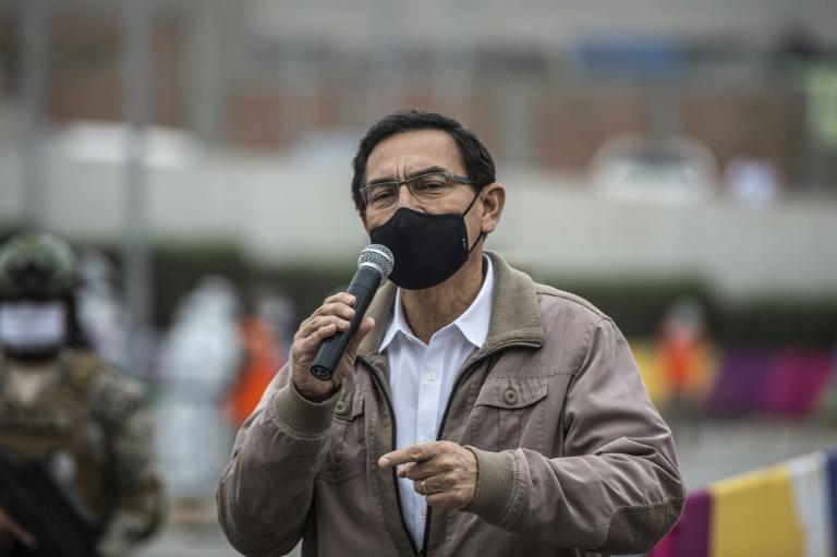 "Peru's President Martin Vizcarra (pictured September 2020) said he will appear before Congress ""carrying in our hands the arguments of the truth"""