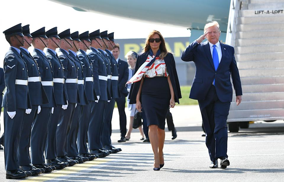 US President Donald Trump (R) and US First Lady Melania Trump (L) walk on the tarmac after disembarking Air Force One at Stansted Airport, north of London on June 3, 2018, as they begin a three-day State Visit to the UK. - Britain rolled out the red carpet for US President Donald Trump on June 3 as he arrived in Britain for a state visit already overshadowed by his outspoken remarks on Brexit. (Photo by MANDEL NGAN / AFP)        (Photo credit should read MANDEL NGAN/AFP/Getty Images)