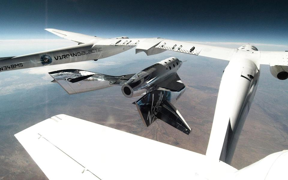 VSS Unity being released from carrier plane VMS Eve - AP