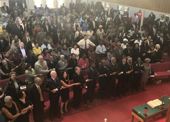 """Presidential candidate and former Vice President Joe Biden, left front, joins the congregation of 16th Street Baptist Church in Birmingham, Alabama, as they sing """"We Shall Overcome"""" at Sunday worship on Sept. 15, 2019.   (Photo: Bill Barrow/AP)"""