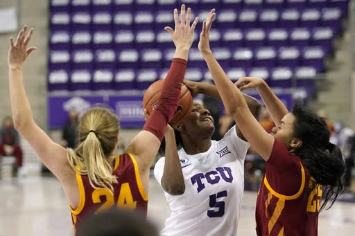 Iowa State guard Ashley Joens (24) and forward Kristin Scott (25) defend as TCU forward Yummy Morris (5) takes a shot in the second half of an NCAA college basketball game in Fort Worth, Texas, Wednesday, Dec. 2, 2020. (AP Photo/Tony Gutierrez)