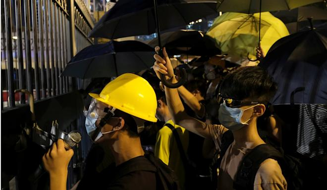 Demonstrators surround a Hong Kong police station where protesters are being held on Wednesday. Photo: Reuters