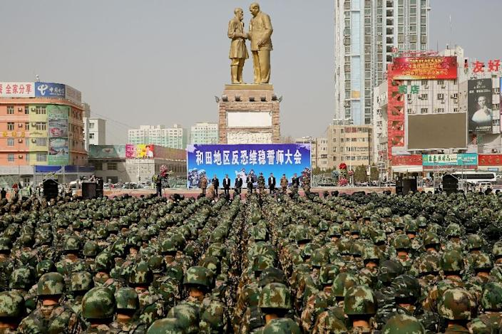 """Chinese military police attended an """"anti-terrorist"""" oath-taking rally last year in northwest China's Xinjiang Uighur Autonomous Region (AFP Photo/STR)"""
