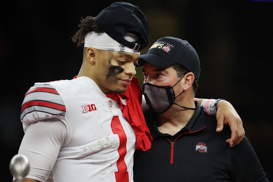 Justin Fields and head coach Ryan Day of the Ohio State Buckeyes react after defeating the Clemson Tigers, 49-28, on Jan 1. (Chris Graythen/Getty Images)