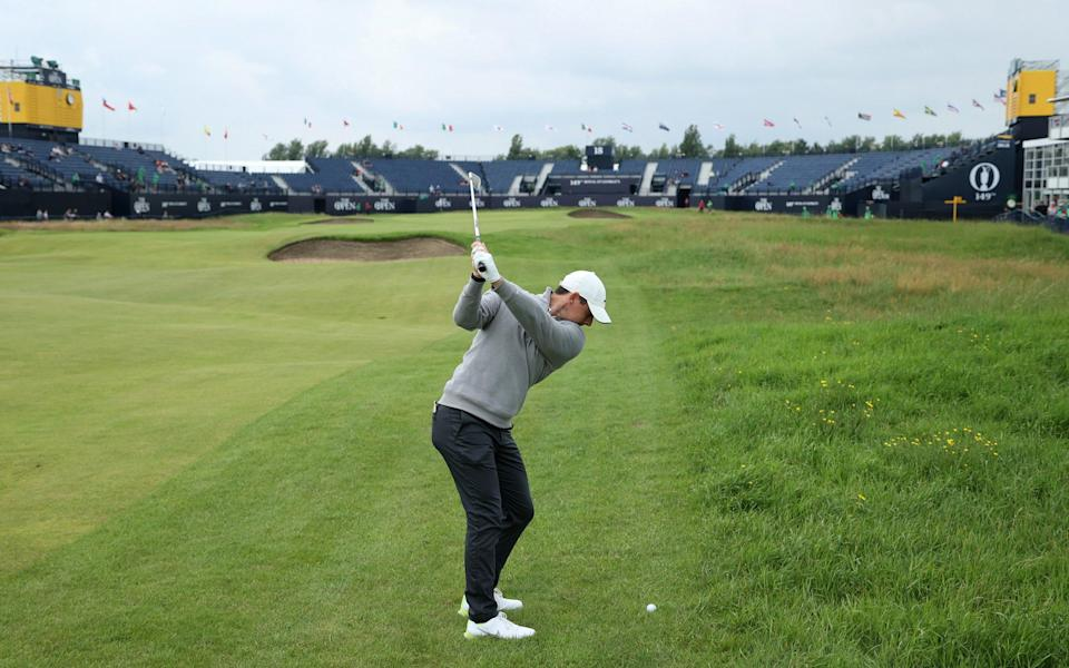 Rory McIlroy of Northern Ireland plays a shot on the eighteenth green during a practice round - Getty Images
