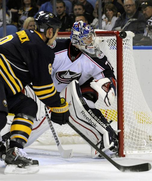 Buffalo Sabres center Cody McCormick (8) chases a rebound as Columbus Blue Jackets goaltender Sergei Bobrovsky (72), of Russia , eyes the puck on the crossbar during the first period of an NHL hockey game in Buffalo, N.Y., Thursday, Oct. 10, 2013. (AP Photo/Gary Wiepert)