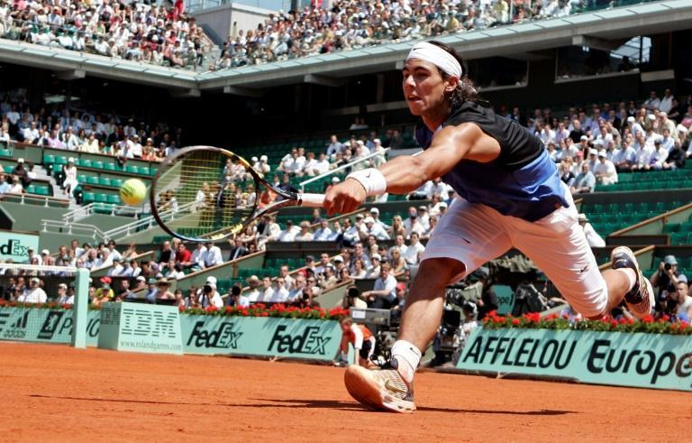 At a stretch: Rafael Nadal returns the ball to Novak Djokovic in their 2006 Roland Garros quarter-final, the pair's first career meeting