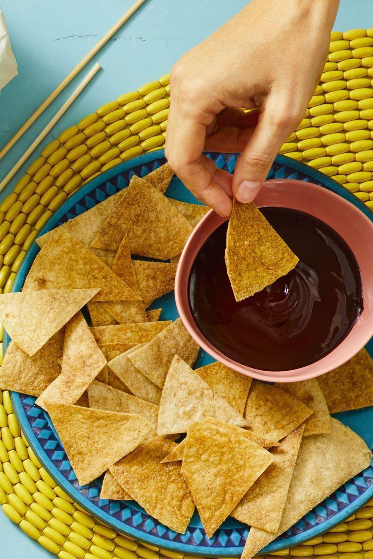 "<p>This Mexican-inspired dessert dip has the perfect balance of sweet and spicy thanks to the chipotle chile mixed in with the chocolate.</p><p><em><a href=""https://www.goodhousekeeping.com/food-recipes/party-ideas/a19864279/churro-chips-with-spiced-chocolate-dip-recipe/"" rel=""nofollow noopener"" target=""_blank"" data-ylk=""slk:Get the recipe for Churro Chips With Spiced Chocolate Dip »"" class=""link rapid-noclick-resp"">Get the recipe for Churro Chips With Spiced Chocolate Dip »</a></em></p>"