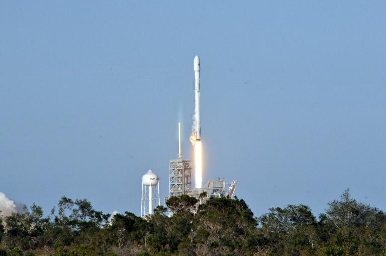 "Space X's recycled Falcon 9 rocket lifts off from Kennedy Space Center, cheered by experts as a ""historic"" moment as companies scramble to lower space travel costs"
