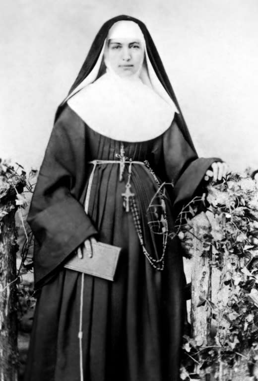 """FILE - This 1883 file photo provided by the Sisters of St. Francis of the Neumann Communities shows Mother Marianne Cope, a nun who dedicated her life to caring for exiled leprosy patients on Kalaupapa in Hawaii. Mother Marianne gave her life to caring for Hawaii's leprosy patients, outcasts that others stayed away from at the time out of fear they might contract the disfiguring disease. On Sunday, Oct. 21, 2012, almost a century after she died at the remote Kalaupapa leprosy settlement in 1918, the Vatican will formally recognize her as a saint. Bishop Larry Silva of the Honolulu diocese says she's """"an inspiration to us to do the hard work, to not always do the glory work, but to roll up our sleeves and do what needs to be done for the sake of our brothers and sisters."""" Two of the seven saints to be canonized on Sunday are American women from upstate New York: the Vatican will also canonize Kateri Tekakwitha, a Mowhawk Indian who spent most of her life in upstate New York. Marianne was born in Utica, N.Y. and entered the sisterhood in Syracuse. (AP Photo/Sisters of St. Francis of the Neumann Communities, File)"""