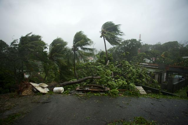 <p>Powerful winds and rains of hurricane Maria battering the city of Petit-Bourg on the French overseas Caribbean island of Guadeloupe on Sept. 19, 2017. (Photo: Cedrik-Isham Calvados/AFP/Getty Images) </p>