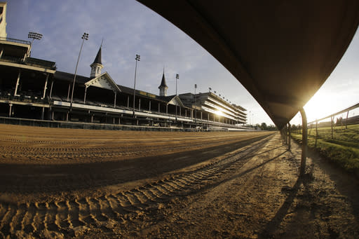 The sun rises over the track at Churchill Downs, Thursday, May 7, 2020, in Louisville, Ky. The Kentucky Derby has been postponed until Sept. 5 because of the coronavirus. (AP Photo/Darron Cummings)