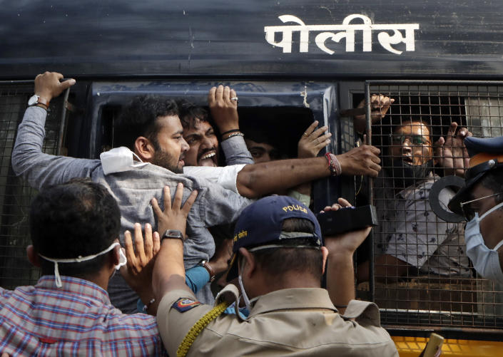 Police detain Bharatiya Janata party workers protesting against Maharashtra state government for the arrest of television news anchor Arnab Goswami in Mumbai, India, Wednesday, Nov. 4, 2020. Indian police on Wednesday said they arrested the Republic TV founder and charged him with abetment to suicide in connection with the 2018 deaths of an interior designer and the designer's mother. (AP Photo/Rajanish Kakade)