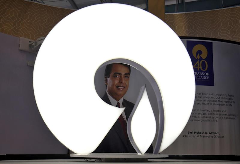 The logo of Reliance Industries is pictured in a stall at the Vibrant Gujarat Global Trade Show at Gandhinagar, India, January 17, 2019. REUTERS/Amit Dave