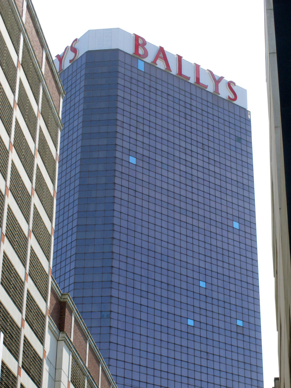 This Oct. 1, 2020 photo shows the exterior of Bally's casino in Atlantic City N.J. The new owners of Bally's Atlantic City are attempting to revive a comatose casino in perhaps the most cutthroat gambling market in America. Rhode Island-based Bally's Corporation is spending at least $90 million on the Boardwalk casino over the next five years, including hotel room makeovers, a renovation of the casino floor, new slot machines and restaurants, and more live entertainment. (AP Photo/Wayne Parry)