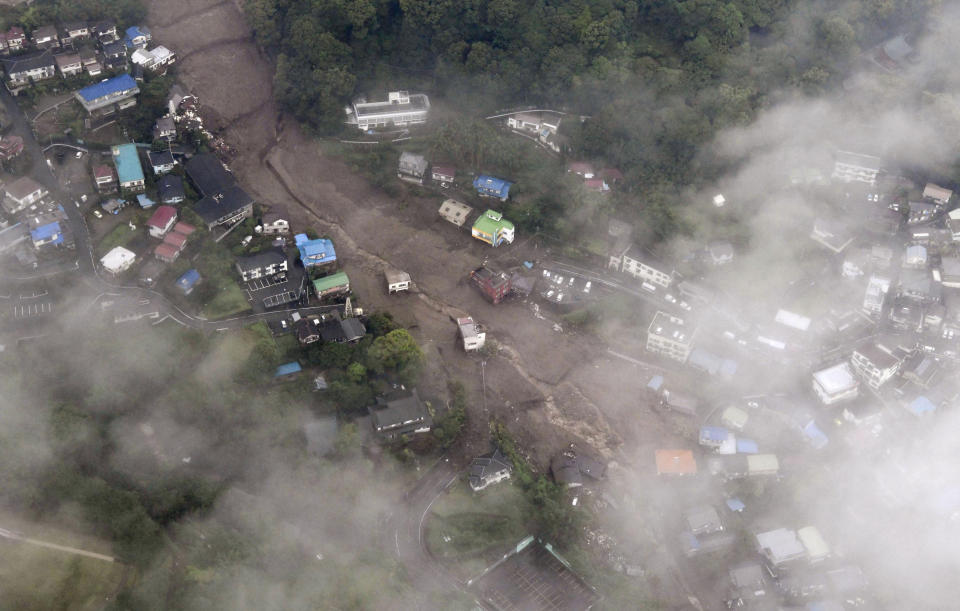 This photo shows a mudslide at the Izusan district in Atami, west of Tokyo, Saturday, July 3, 2021, following heavy rains in the area. The mudslide carrying a deluge of black water and debris crashed into rows of houses in the town following heavy rains on Saturday, leaving multiple people missing, officials said. (Kyodo News via AP)