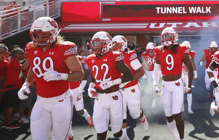 Utah cornerback Aaron Lowe (22) runs with his teammates onto the field before an NCAA college football game against Washington State Saturday, Sept. 25, 2021, in Salt Lake City, Utah. A University of Utah football player has been killed in a shooting at a house party early Sunday, Sept. 26, 2021, Salt Lake City police said. The shooting that killed Aaron Lowe occurred just after midnight, only hours after the Utes beat Washington State 24-13. Police said another victim in the attack was in critical condition and authorities were searching for a suspect. (AP Photo/George Frey)