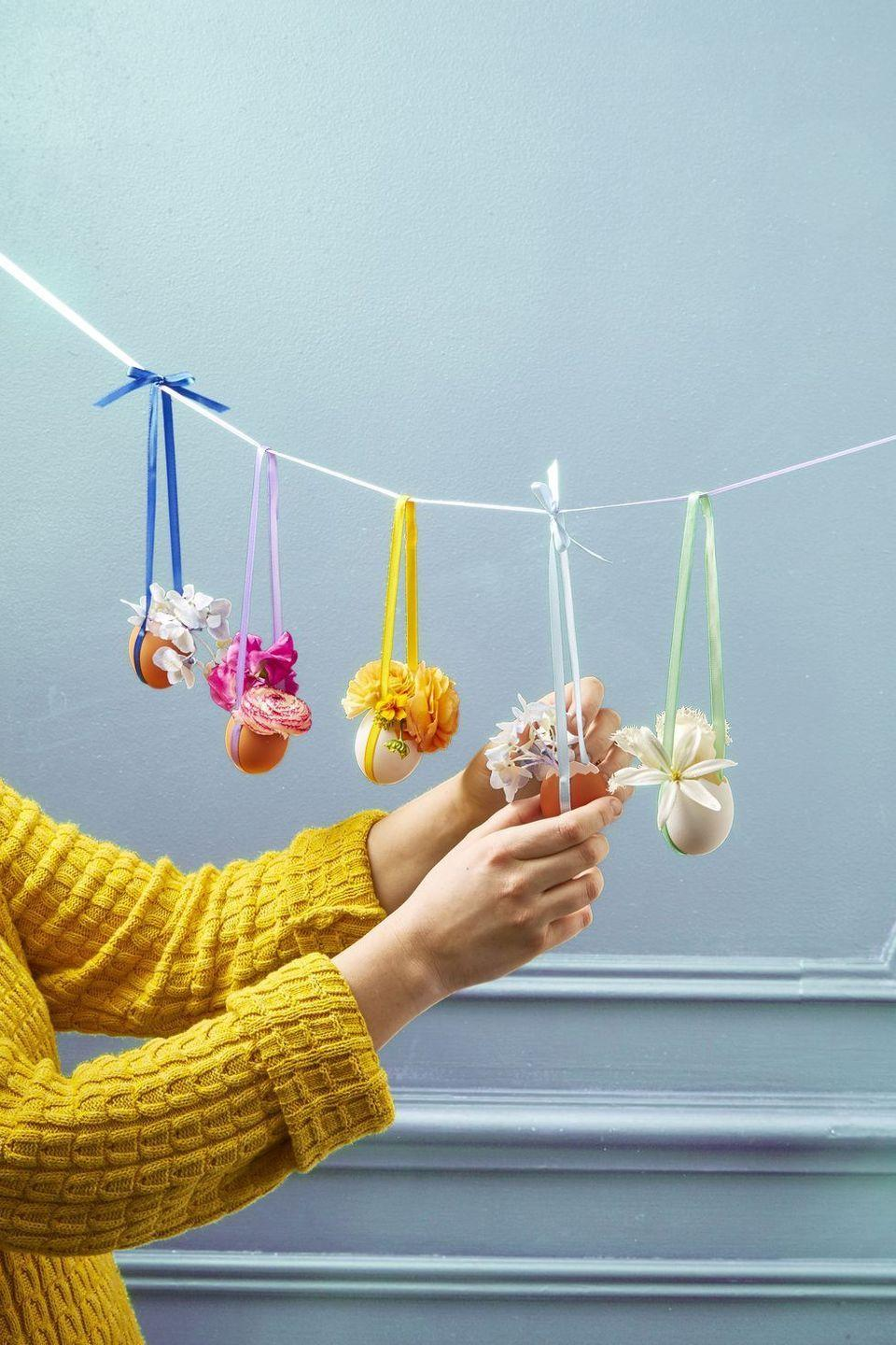 """<p>This colorful egg-shell garland is an Easter party must-have. Plus, it's so easy to make!</p><p><strong><em>Get the tutorial at <a href=""""https://www.goodhousekeeping.com/holidays/easter-ideas/g711/easter-spring-crafts/?slide=27"""" rel=""""nofollow noopener"""" target=""""_blank"""" data-ylk=""""slk:Good Housekeeping"""" class=""""link rapid-noclick-resp"""">Good Housekeeping</a>.</em></strong></p><p><strong><a class=""""link rapid-noclick-resp"""" href=""""https://www.amazon.com/LaRibbons-Solid-Ribbon-Colors-Package/dp/B009V35YVC/?tag=syn-yahoo-20&ascsubtag=%5Bartid%7C10070.g.1751%5Bsrc%7Cyahoo-us"""" rel=""""nofollow noopener"""" target=""""_blank"""" data-ylk=""""slk:SHOP SATIN RIBBON"""">SHOP SATIN RIBBON</a></strong></p>"""