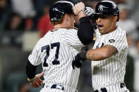 New York Yankees Clint Frazier (77) celebrates with Rougned Odor after scoring on Odor's eighth-inning, two-run, home run in a baseball game against the Kansas City Royals, Wednesday, June 23, 2021, at Yankee Stadium in New York. (AP Photo/Kathy Willens)