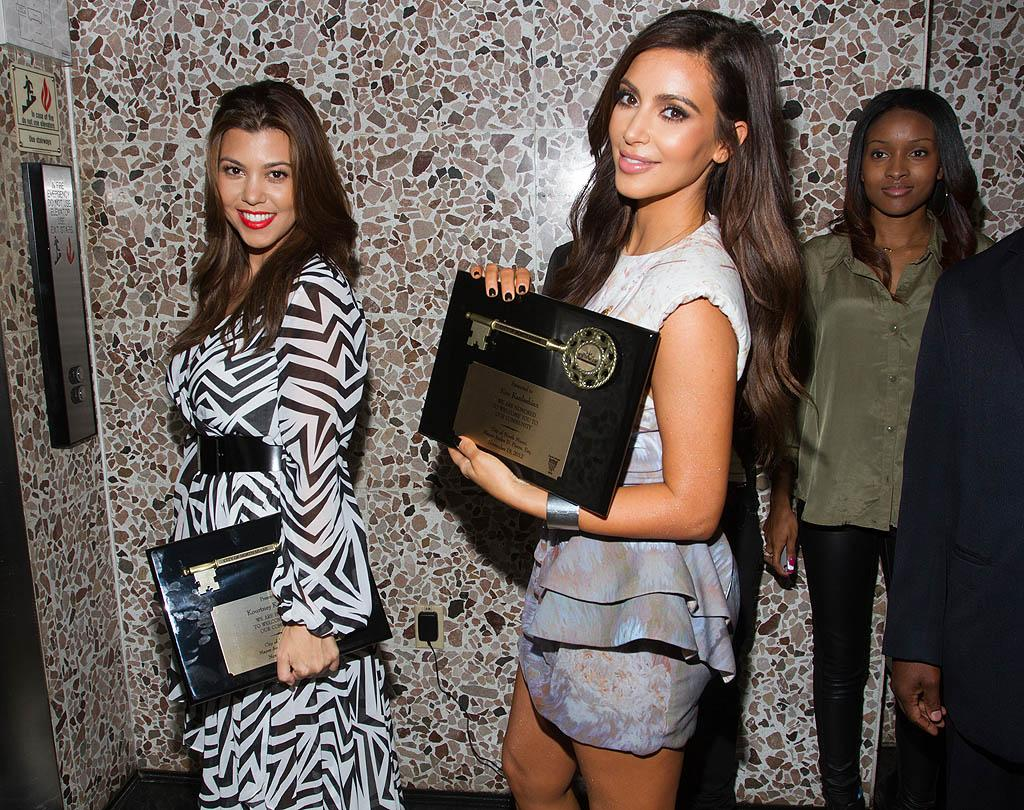 NORTH MIAMI, FL - NOVEMBER 19: Kourtney Kardashian and Kim Kardashian make an appearance at North Miami City Hall to receive key to the City Of North Miami on November 19, 2012 in North Miami, Florida. (Photo by John Parra/WireImage)