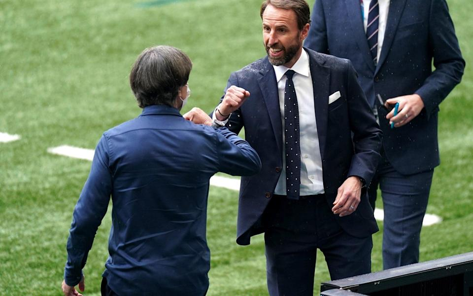 Greetings betweenGareth Southgate (right) and Germany manager Joachim Low - PA