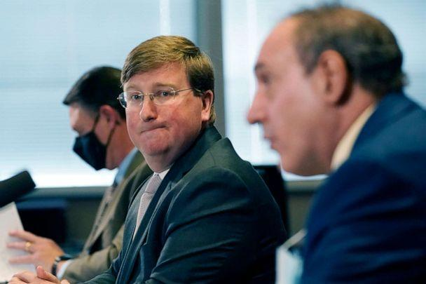 PHOTO: Gov. Tate Reeves, left, listens as State Epidemiologist Dr. Paul Byers, answers a reporter's question during his media update on the current situation of COVID-19 in Mississippi, Tuesday, Feb. 23, 2021, in Jackson, Miss. (Rogelio V. Solis/AP, FILE)