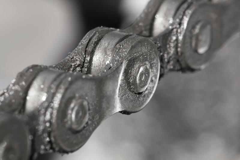 Close-up of a well-oiled bike chain.