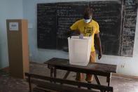 A man casts his vote during presidential election in Abidjan, Ivory Coast, Saturday, Oct. 31, 2020. Tens of thousands of security forces deployed across Ivory Coast on Saturday as the leading opposition parties boycotted the election, calling President Alassane Ouattara's bid for a third term illegal. (AP Photo/Leo Correa)
