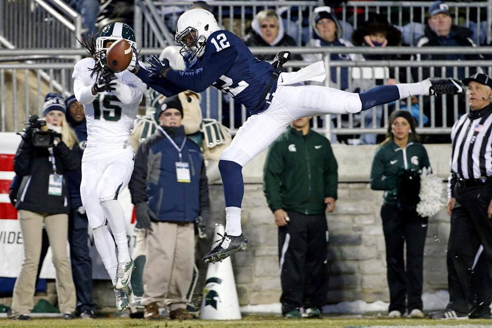 Penn State wide receiver Chris Godwin (12) can't hang onto a pass in the end zone as Michigan State cornerback Trae Waynes (15) comes up with the interception for a touchback during the second half of an NCAA college football game in State College, Pa., Saturday, Nov. 29, 2014. (AP Photo/Gene J. Puskar)