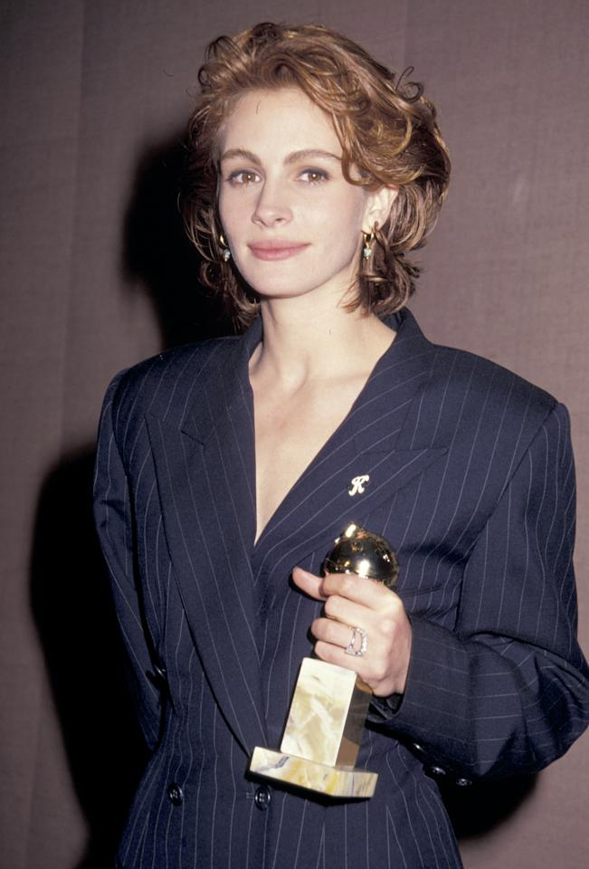 <p>Celebrating her Golden Globe win for her role in <em>Pretty Woman</em>, Roberts wears her newly chopped bob in tousled curls with a natural lip at the 48th Annual Golden Globe Awards. 1991.</p>