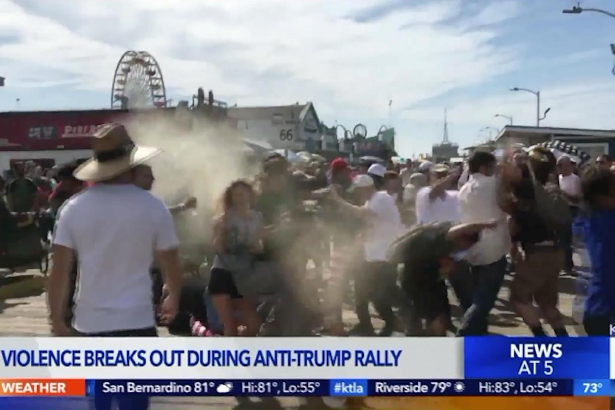 Image result for Man In MAGA Hat Sprays Anti-Trump Protesters With Bear Repellent Sending Them Running