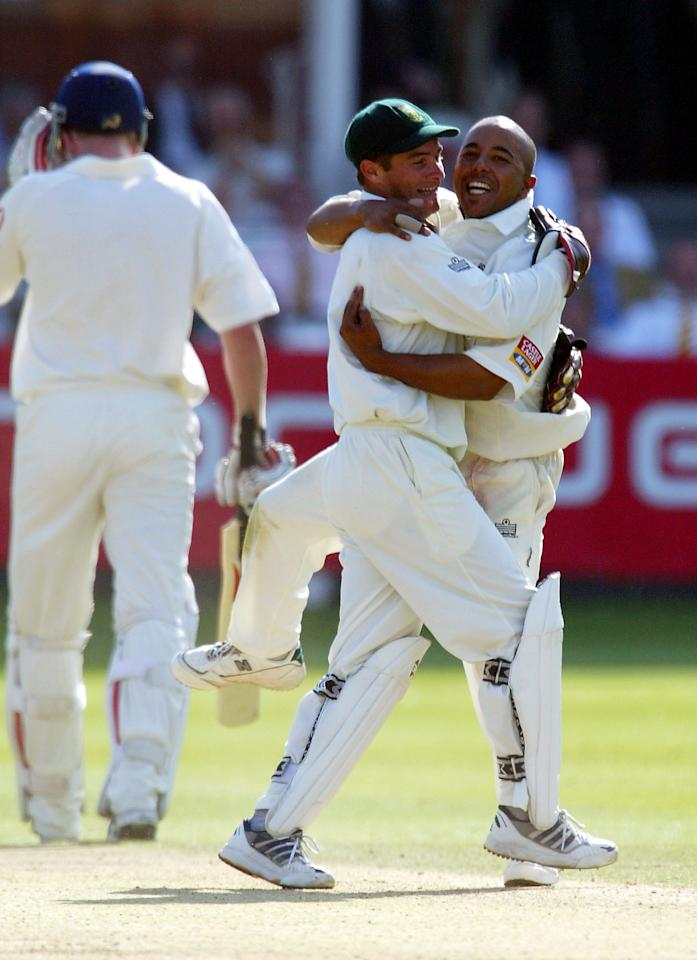 LONDON - AUGUST 3:  Paul Adams of South Africa (R) congratulates Mark Boucher of South Africa after stumping Andrew Flintoff of England to end the match during the fourth day of the second npower test match between England and South Africa on August 3, 2003 at Lords Cricket Ground in London. (Photo By Stu Forster/Getty Images)