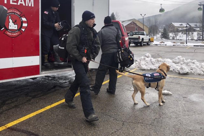 In this Tuesday, Jan. 7, 2020, photo provided by KHQ, the Coeur d'Alene Fire Department K-9 Team responds to Silver Mountain for an avalanche in Kellogg, Idaho. Officials are searching for a person who was skiing at an Idaho resort near where avalanches killed two skiers and injured five others. The Silver Mountain Resort near the town of Kellogg was closed Wednesday to focus resources on the search for the missing skier. (KHQ via AP)