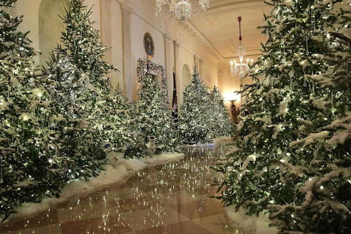 """<p>The Cross Hall at the White House during a press preview of the 2017 holiday decorations Nov. 27, 2017 in Washington, D.C. The theme of the White House holiday decorations this year is """"Time-Honored Traditions."""" (Photo: Alex Wong/Getty Images) </p>"""