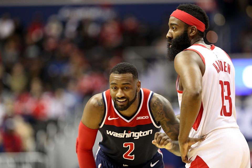 John Wall #2 of the Washington Wizards talks with James Harden #13 of the Houston Rockets in the second half at Capital One Arena on November 26, 2018 in Washington, DC. NOTE TO USER: User expressly acknowledges and agrees that, by downloading and or using this photograph, User is consenting to the terms and conditions of the Getty Images License Agreement. (Photo by Rob Carr/Getty Images)