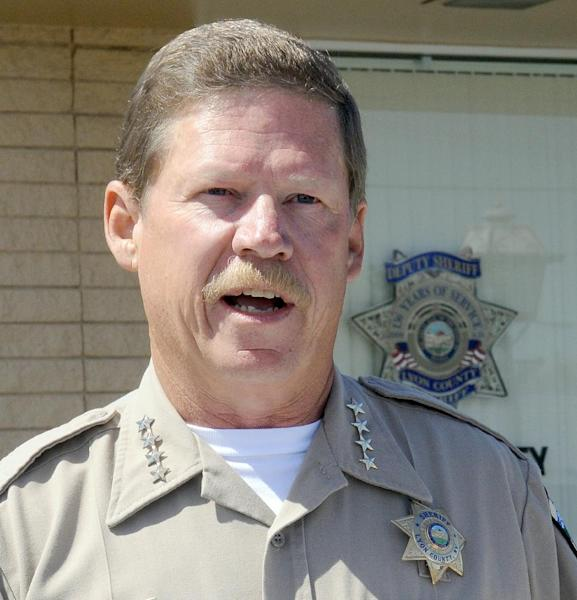 Lyon County Sheriff Allen Veil addresses the media Tuesday, May 14, 2013 regarding the four murders that occurred in that county the day before. A fifth body was found in Washoe County at I-80 and the Mustang exit. (AP Photo/The Gazette-Journal, Marilyn Newton)