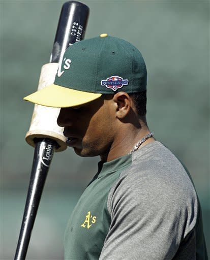 Oakland Athletics' Yoenis Cespedes waits to bat during practice in preparation for Game 3 of the American League division baseball series against the Detroit Tigers, Monday, Oct. 8, 2012, in Oakland, Calif. Their game is scheduled for Tuesday in Oakland. (AP Photo/Ben Margot)