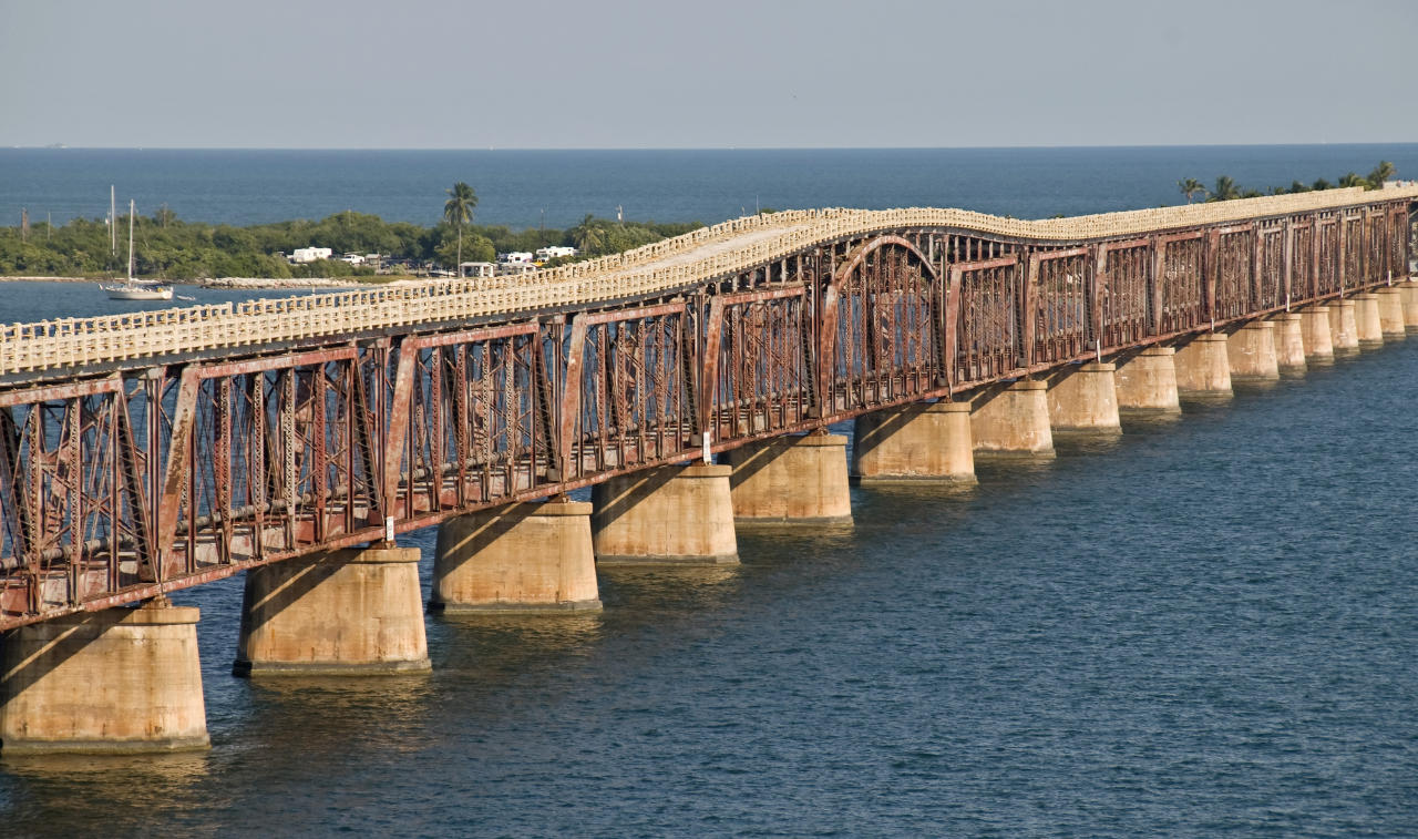 This Jan. 1, 2012, photo provided by the Florida Keys News Bureau shows a portion of the original Bahia Honda trestle bridge in the Florida Keys, at Bahia Honda Key, Fla. The bridge was built in the early 1900s to carry Henry Flagler's Florida Keys Over-Sea Railroad on the lower deck. Following the railroad's demise in 1935, a top deck on the bridge was created to carry automobiles. A different and wider bridge for the Florida Keys Overseas Highway was constructed in 1972. The centennial anniversary of the completion of the railroad is Jan. 22, 2012. (AP Photo/Florida Keys News Bureau, Andy Newman)