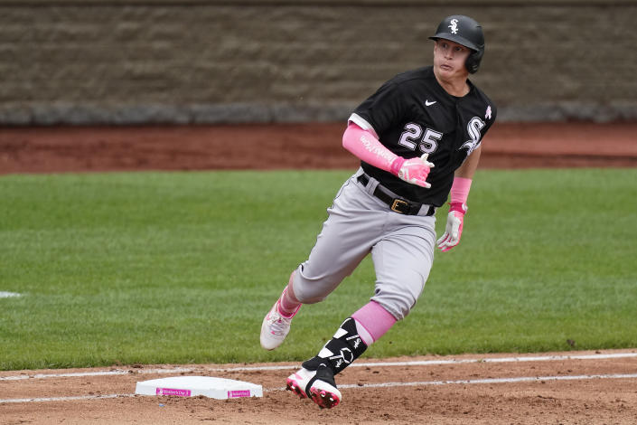 Chicago White Sox's Andrew Vaughn runs to second after hitting a double during the sixth inning of a baseball game against the Kansas City Royals Sunday, May 9, 2021, in Kansas City, Mo. (AP Photo/Charlie Riedel)