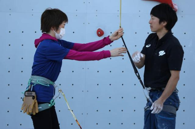 Tokyo 2020 staff participate in a test event for the sports climbing, replacing the athletes due to concerns over the spread of coronavirus at Aomi Urban Sports Park in Tokyo