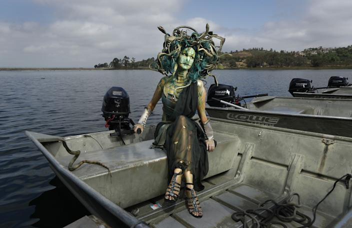 "Sheila Noseworthy dressed as Medusa at Lake Miramar. Noseworthy took a month to make this outfit out of foam and Dollar Store finds. She has been going to Comic-Con for 10 years, and says it is one of the best places to people-watch, even if you don't have a ticket. ""Going in cosplay gives you a license to go chat with other cosplay people and makes you appreciate all the arts and comics,"" she added. <span class=""copyright"">(K.C. Alfred / The San Diego Union-Tribune)</span>"