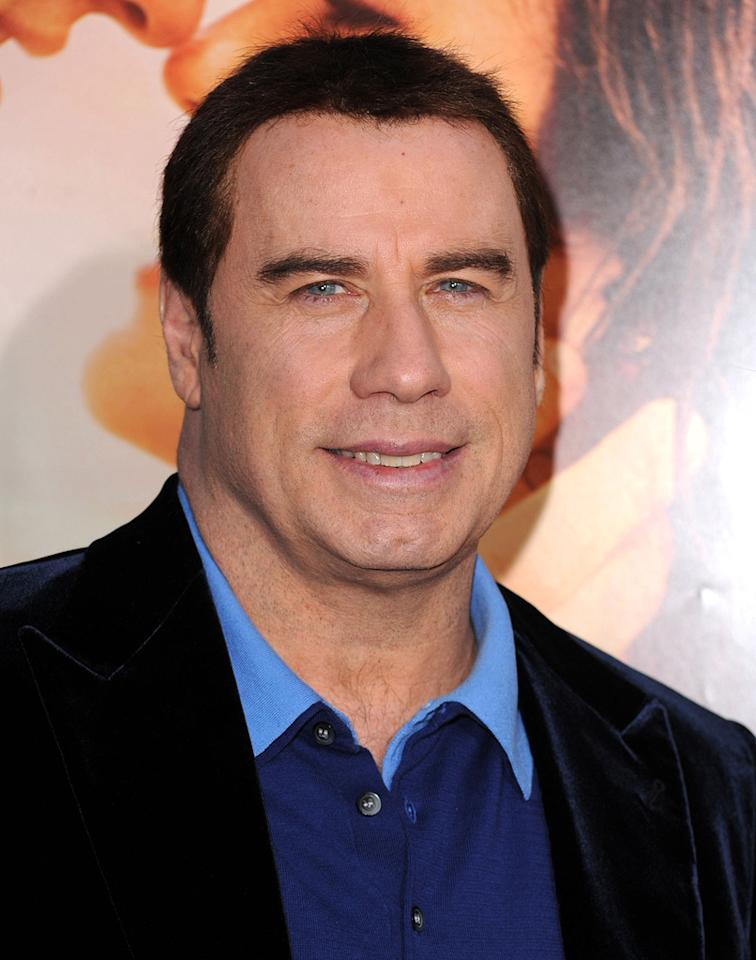 "<a href=""http://movies.yahoo.com/movie/contributor/1800019533"">John Travolta</a> at the Los Angeles premiere of <a href=""http://movies.yahoo.com/movie/1810098775/info"">The Last Song</a> - 03/25/2010"
