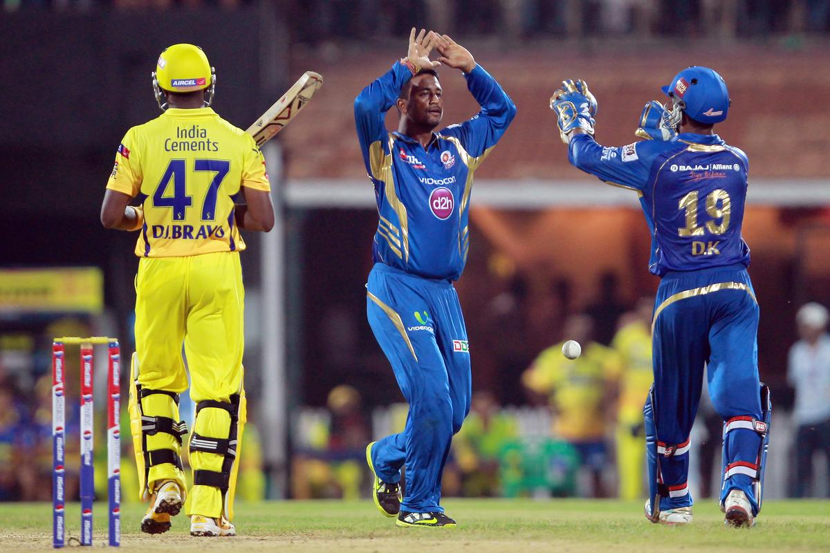 Pragyan Ojha celebrates the wicket of Dwayne Bravo during match 5 of of the Pepsi Indian Premier League between The Chennai Superkings and the Mumbai Indians held at the MA Chidambaram Stadiumin Chennai on the 6th April 2013. Photo by Jacques Rossouw-IPL-SPORTZPICS..Use of this image is subject to the terms and conditions as outlined by the BCCI. These terms can be found by following this link:..https://ec.yimg.com/ec?url=http%3a%2f%2fwww.sportzpics.co.za%2fimage%2fI0000SoRagM2cIEc&t=1490345157&sig=u4L5yKRmIygS3a7fWTth3Q--~C