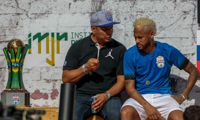 Neymar, pictured here with his father, is yet to return to Paris for pre-season training and on Saturday played in a five-a-side football tournament for his charity Neymar Junior Project Institute near Sao Paulo (AFP Photo/Miguel SCHINCARIOL)
