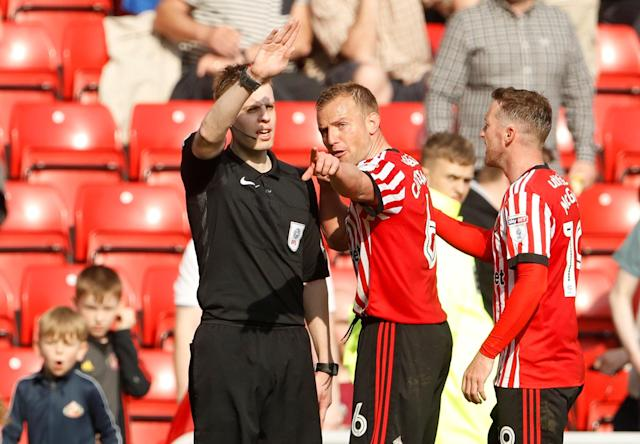 "Soccer Football - Championship - Sunderland v Burton Albion - Stadium of Light, Sunderland, Britain - April 21, 2018 Sunderland's Lee Cattermole remonstrates with a linesman after a goal is disallowed Action Images/Lee Smith EDITORIAL USE ONLY. No use with unauthorized audio, video, data, fixture lists, club/league logos or ""live"" services. Online in-match use limited to 75 images, no video emulation. No use in betting, games or single club/league/player publications. Please contact your account representative for further details."